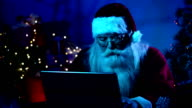 Santa uses a laptop in the moonlight video