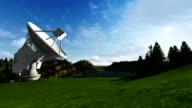 Satellite Antenna on Green Meadow, timelapse, camera panning video