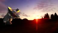 Satellite Antenna on Green Meadow, timelapse sunset, camera panning video