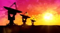 Satellite dish antennas at sunset video