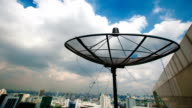 A satellite dish moves in time-lapse video