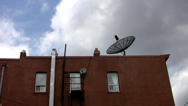 Satellite dish on rooftop. video