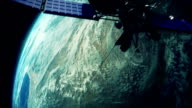 Satellite orbiting earth video