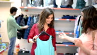 Satisfied customer holding clothes in supermarket video