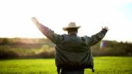 Satisfied farmer on farmland video