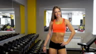 Satisfied fitness woman posing after successful training, inside gym video
