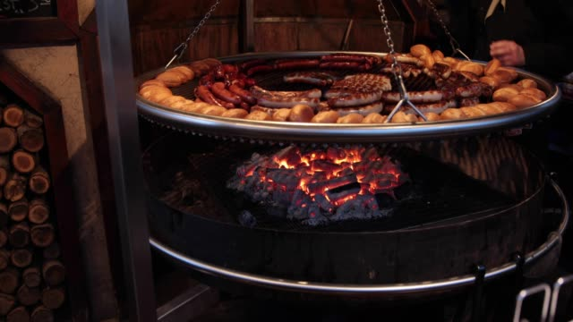 Sausages cooking on charcoal fire at  German Christmas Market video