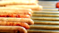 Sausages fried on the stove. video