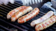 Sausages prepared on the grill grate video