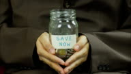 Save money for investment concept money in the glass jar video