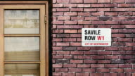 Savile Row street sign. The world's most famous street of Savile Row in London. video