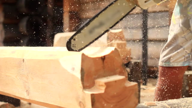 Saw sawing wood for home video