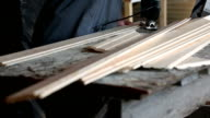 Sawing wooden tongue and groove boards video