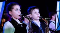 Saxophonists of children's jazz band video