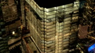 AERIAL, CLOSE UP: Scaffolded skyscraper in Downtown Manhattan financial district video