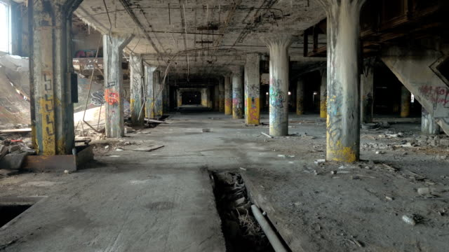 CLOSE UP: Scary ruined garage in abandoned Fisher Body Plant automotive factory video