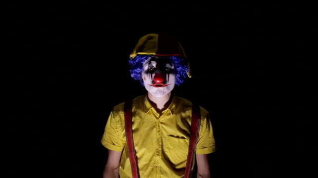 Scary shot of a spooky clown video