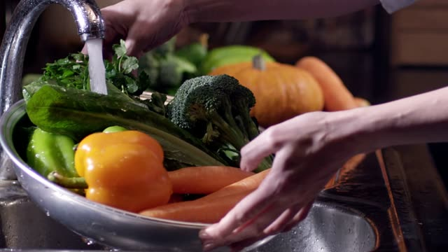 Scene of washing fresh vegetables. broccoli, pepper and carrots. Under the tap. Shot on RED EPIC Cinema Camera in slow motion. video