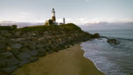 Scenic aerial footage of the Montauk Lighthouse at sunset, with camera climbing. video