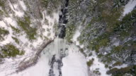 Scenic aerial reveal of waterfall and surrounding forest video