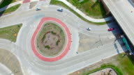 Scenic Aerial Time Lapse of Roundabout, Traffic Driving in Circle video