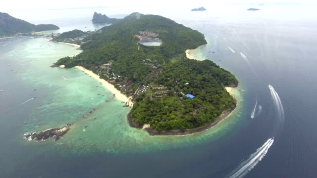 Scenic aerial view of white beach with crystal-clear water, Aerial view video