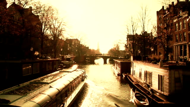 Scenic Amsterdam Canal Scene at Sunset video
