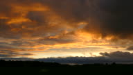 Scenic, Dramatic Dusk Clouds Drift Over Dark Landscape video