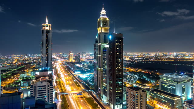 Scenic Dubai downtown architecture night timelapse. Top view over Sheikh Zayed road with illuminated skyscrapers and traffic video