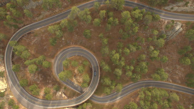 AERIAL: Scenic pigtail bridge drive on Iron Mountain Road steep windy highway video