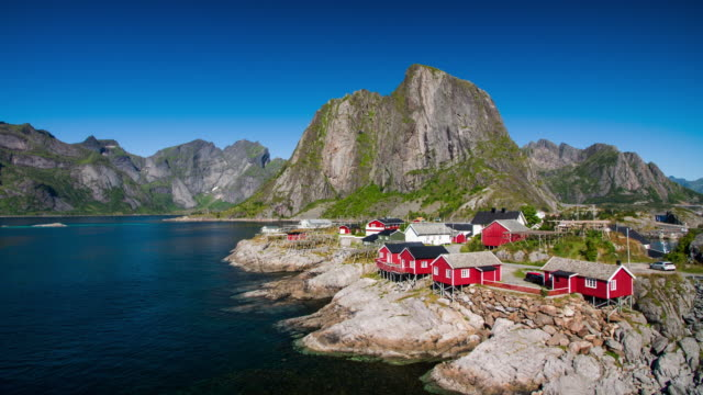 Scenic town of Reine by the fjord on Lofoten islands in Norway on sunny summer day video