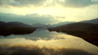 Scenic video of calm lake and mountains against cloudy sky video