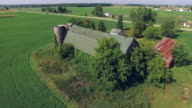 Scenic View of Abandoned Rustic Barn and Silos video