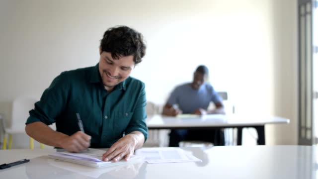 Scholars writing an exam video