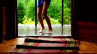 Schollgirl running out of the house and dancing barefeet on wet porch under rain video