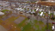 School Bus Drives Through Flooded Mobile Home Park video