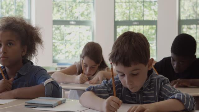 School Bus Student Montage Spelling 4K 4:2:2 Slow motion video