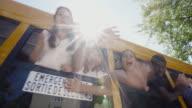 School Bus Windows Student Waving 4K 4:2:2 Slow motion video
