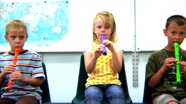 School children playing instruments video