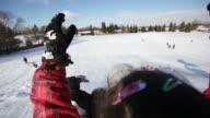School children tobogganing down a playground hill during winter recess video