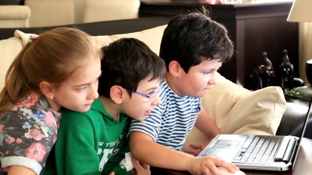 School children using computer video