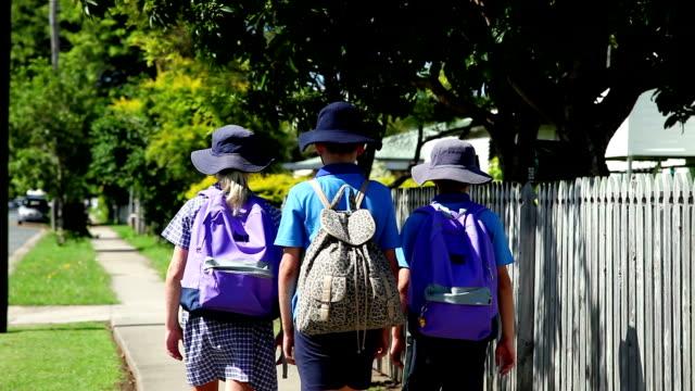 School Children Walking to school rear view unrecognizable video