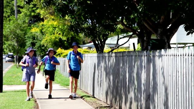 School Children Walking with backpacks having fun video