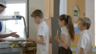 School Pupils Being Served Lunch In Canteen Shot On R3D video