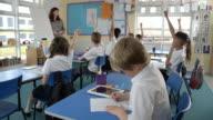 School Pupils In Maths Class With Teacher Shot On R3D video