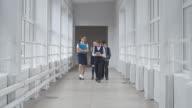 School Students Walking Along Hallway video