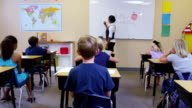 School teacher asks elementary students questions video