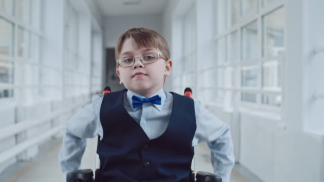 Schoolboy in Wheelchair Riding to Lessons video