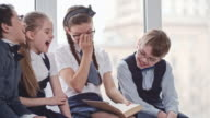 Schoolboys and Schoolgirls Reading Funny Stories video