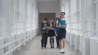 Schoolchildren Walking Along School Hallway video